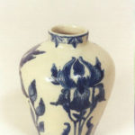 Blue & white vase with incised flowers.