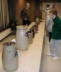 Members admire Wisconsin stoneware